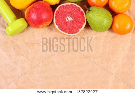 Fresh Ripe Fruits And Dumbbells For Fitness, Concept Of Healthy Lifestyles