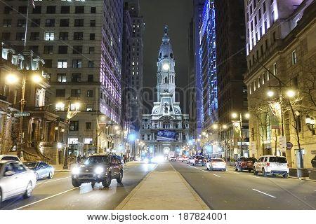 Philadelphia street view at night with city hall  -  2017