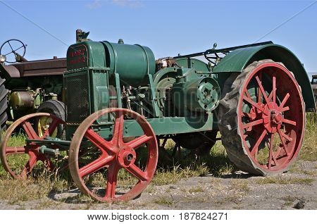 BARNESVILLE, MINNESOTA, September, 14, 2014: The old rusty Hart-Parr  tractor comes from Hart-Parr Tractor Company which began operations in 1897 and sold out to Oliver Tractor company in 1929.