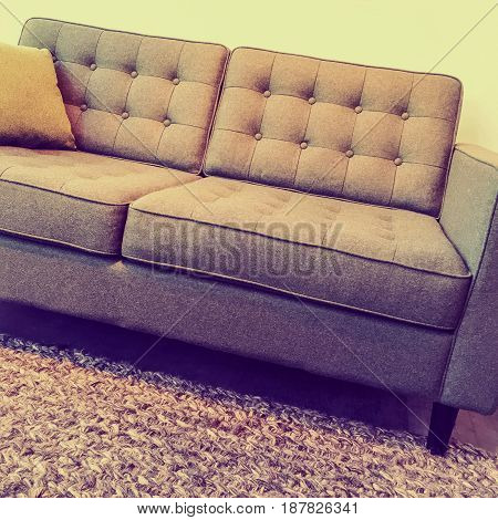 Retro style elegant and comfortable sofa on a knitted rug.