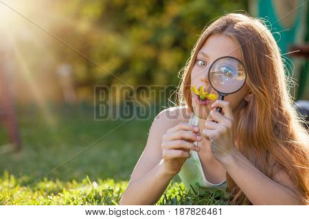 explorer girl studying with magnify glass