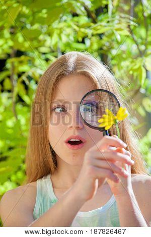 little girl inspecting wild life