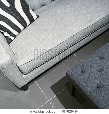 Detail of a living room in gray tones. Contemporary furniture.