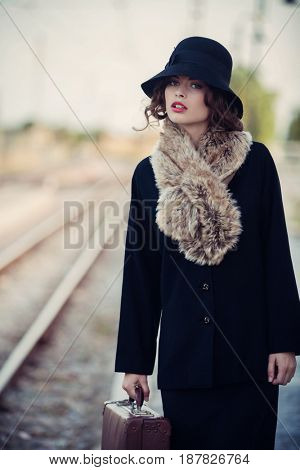 50`s woman at old railway station