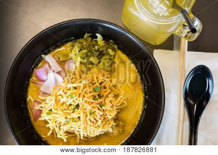 Spicy Yellow Curry With Crispy Noodle stock photo