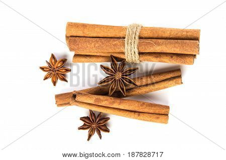 Close up brown cinnamon stick with star anise spice isolated on white background overhead and top view