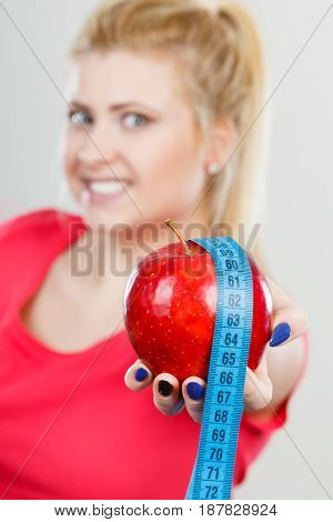 Happy Woman Holding Apple And Measuring Tape