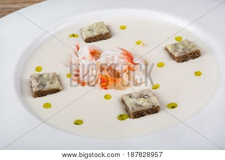 Bowl of creamy crab meat soup with croutons