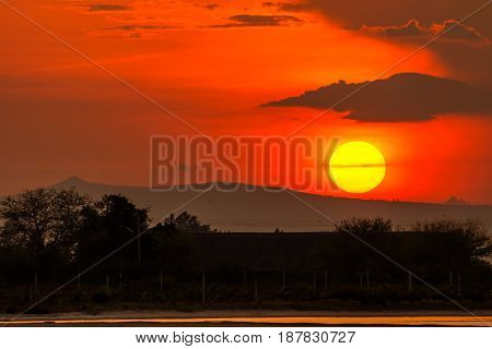 View of sunset over mountain in rural.