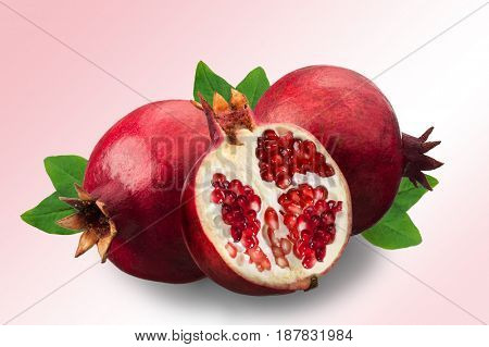 Image of ripe pomegranates and leaves isolated on a pink and white background