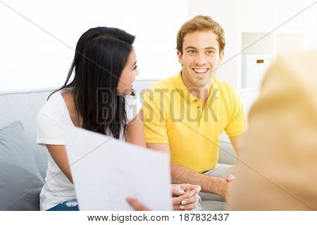 Young mixed race couple meeting with consultant (or counselor financial adviser real estate agent etc.)