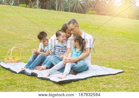 asian family having fun time at outdoor