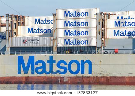 Oakland CA - May 22 2017: Matson cargo ship MAUI maneuvering into the Port of Oakland. Matson provides shipping services Pacific wide. Mainly to and from the Hawaiian Islands.