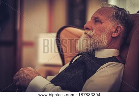 Well-dressed senior man in luxury interior