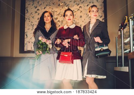 Three elegant young ladies ready for a party