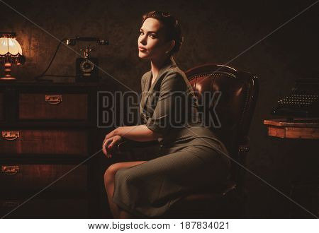 Beautiful young woman in retro interior