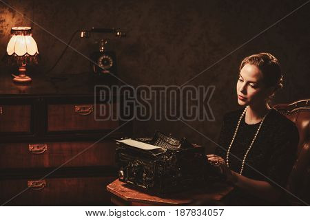 Beautiful young woman typing in retro interior