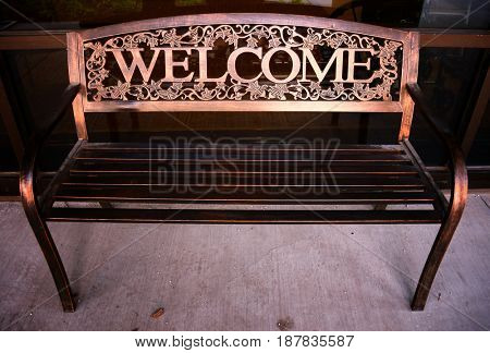 Copper welcome bench outside an office building