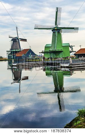 Wooden Windmills Zaanse Schans Old Windmill Village Countryside Holland Netherlands. Working windmills from the 16th to 18th century on the River Zaan. Windmills powered industries in Holland such as ship builidng vegetable oil production.