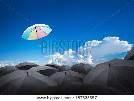 Abstract Umbrella Flying Over Many Black Umbrellas With Beautiful Sky, Leadership Background Concept