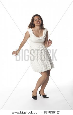 Smiling Hispanic woman dancing