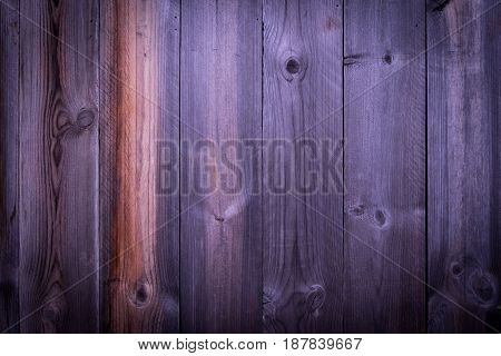 Vintage pine wooden wall with random texture background with vignette effect.