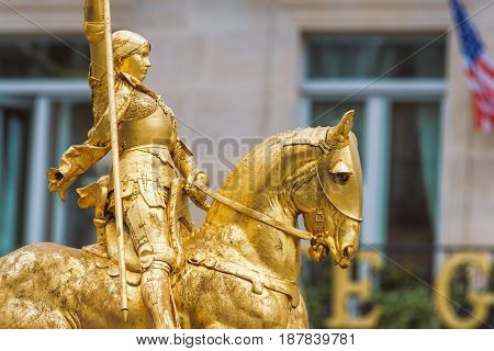 Paris France - May 2 2017: Close-up Side view shot of the golden statue of Joan of Arc at Place des Pyramides on May 02 2017 in Paris France.
