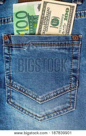 Dollar and euro banknotes in jeans pocket. Financial concept
