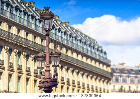 Paris France - May 2 2017: the ancient light pole with the old buildings and blue sky in a background on May 2 2017 in Paris France.