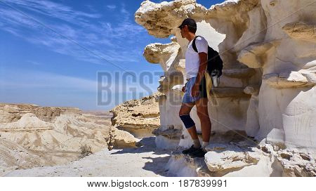 Man Stands At Background Of Canyon Ein Avdat