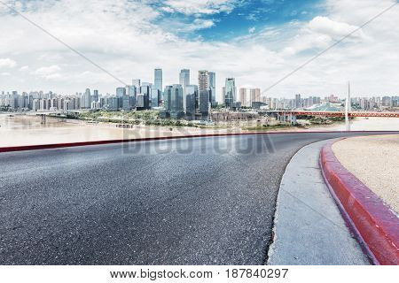 modern buildings near river in chongqing from empty road