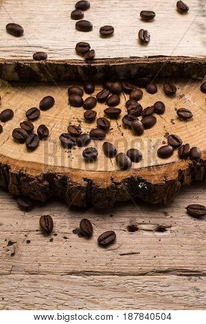 coffee beans   on wooden surface background. rustic