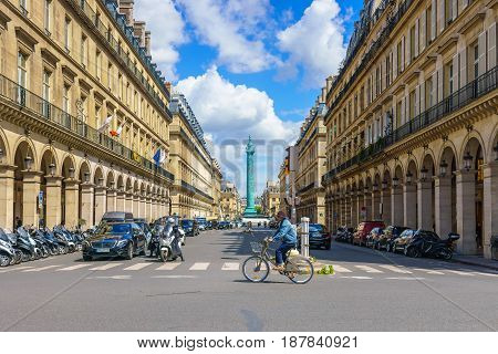 Paris France - May 2 2017: Traffic conditions on Castiglione Street and the beautiful old architecture along the way with Place Vendome Square in a background on May 2 2017 in Paris France.