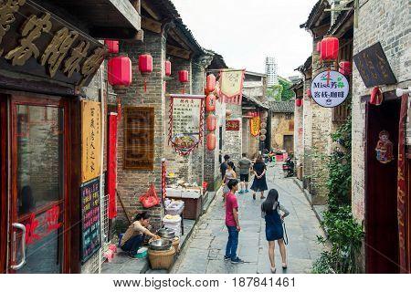 He Zhou, China - May 2, 2017: Tourists Walking In The Huang Yao Ancient Town In Zhaoping County, Gua
