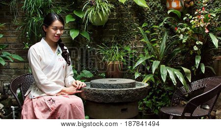 Girl Sitting In Beautifully Decorated Backyard