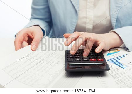 Financial accounting. Business woman using calculator