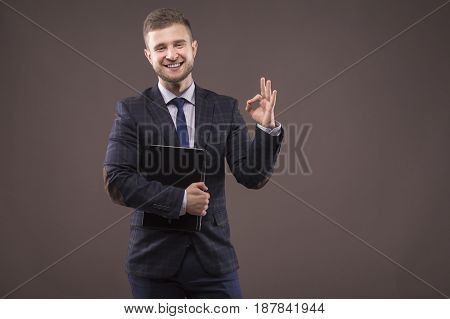 Young Man Showing Sign Of Ok