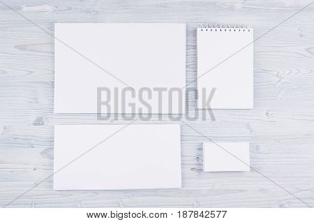 Corporate identity template stationery on soft light blue wooden board. Mock up for branding graphic designers presentations and portfolios.