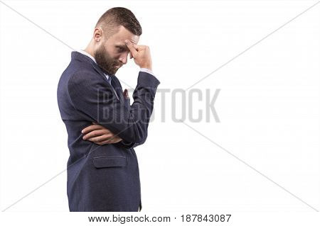 Man thoughtfully put his hand to his head and ponders
