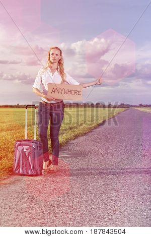 Full length of woman hitching while holding anywhere sign on country road