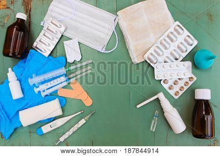 Medical items and tablets on table. Top view.