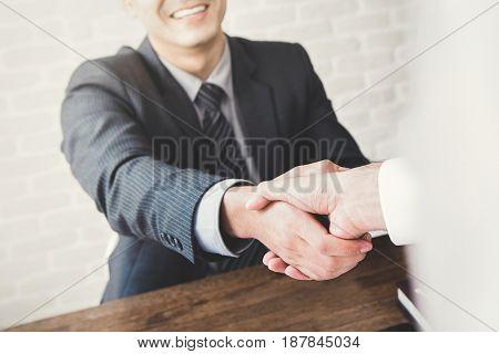 Businessmen making handshake - partnership greeting and dealing concepts