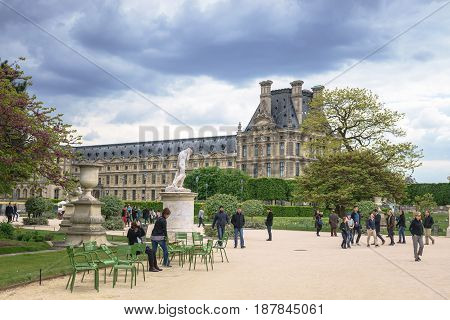 Paris France - May 2 2017: Tuileries Garden in evening with a crowd on May 02 2017 in Paris France.