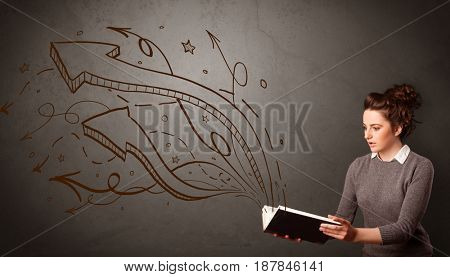 Casual young woman holding book with brown arrows and stars flying out of it