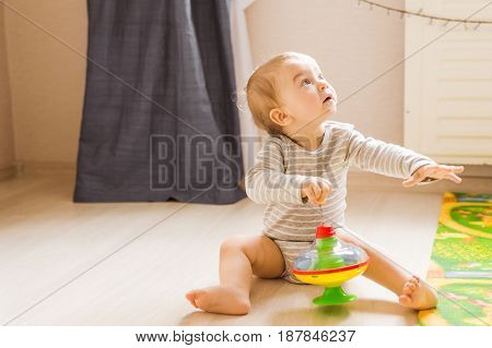 child boy toddler playing with toy indoors.