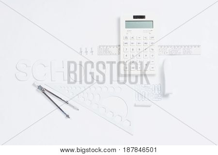 Calculator With Rulers And Stapler With Compasses Mock-up Isolated On White