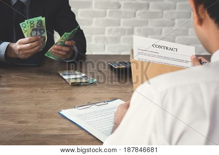 Business partner making a contract - loan bribery and corruption concepts