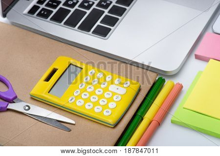Laptop Computer And Colorful School Supplies Isolated On White