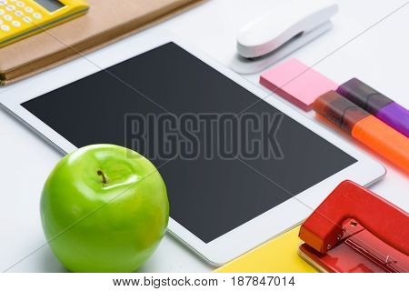 Digital Tablet With Blank Screen And Colorful School Supplies Isolated On White