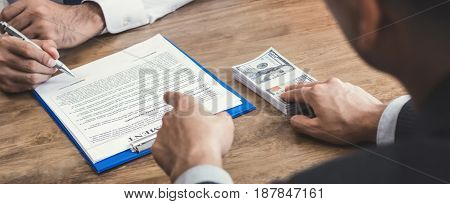 Businessman offering money and command to sign while making agreement - bribery and corruption concepts panoramic banner